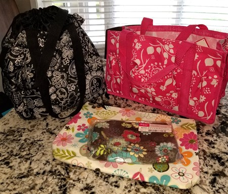 Hot pink All-in-One Tote, black paisley thermal lunch bag, large floral zipper pouch, and a small zipper pouch in a brown floral print. All are new or like new condition.