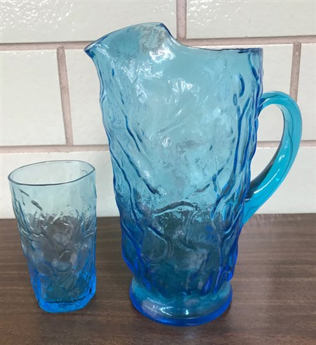 Blue glass pitcher with 12 matching glasses.
